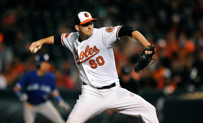 Sep 25, 2013; Baltimore, MD, USA; Baltimore Orioles pitcher Josh Stinson (60) throws in the sixth inning against the Toronto Blue Jays at Oriole Park at Camden Yards. The Orioles defeated the Blue Jays 9-5. Mandatory Credit: Joy R. Absalon-USA TODAY Sports