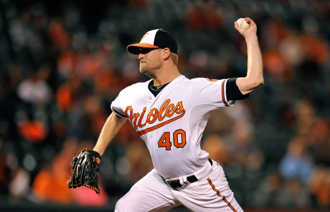 Sep 25, 2013; Baltimore, MD, USA; Baltimore Orioles pitcher Troy Patton (40) throws in the seventh inning against the Toronto Blue Jays at Oriole Park at Camden Yards. The Orioles defeated the Blue Jays 9-5. Mandatory Credit: Joy R. Absalon-USA TODAY Sports