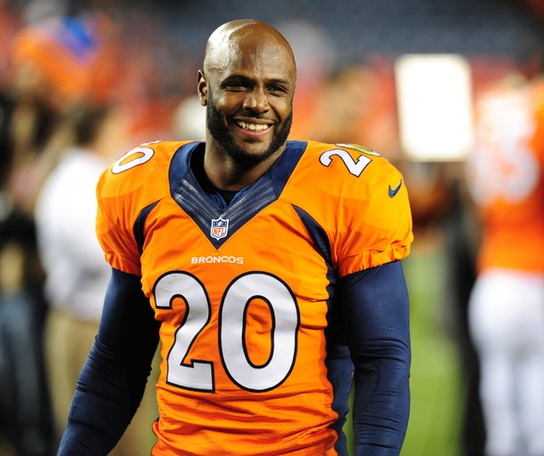 Sep 23, 2013; Denver, CO, USA; Denver Broncos safety Mike Adams (20) after the game against the Oakland Raiders at Sports Authority Field at Mile High.  The Broncos won 37-21. Mandatory Credit: Chris Humphreys-USA TODAY Sports