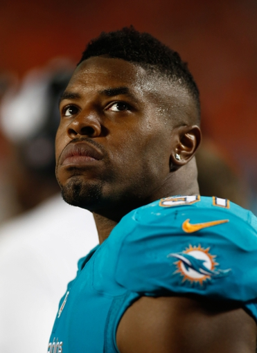 Aug 24, 2013; Miami Gardens, FL, USA;  Miami Dolphins defensive end Cameron Wake (91) in the second half at Sun Life Stadium. Tampa Bay won 17-16.  Mandatory Credit: Robert Mayer-USA TODAY Sports