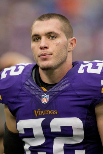 Sep 22, 2013; Minneapolis, MN, USA; Minnesota Vikings safety Harrison Smith (22) leaves the field after losing to the Cleveland Browns at Mall of America Field at H.H.H. Metrodome. The Browns win 31-27. Mandatory Credit: Bruce Kluckhohn-USA TODAY Sports