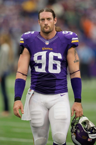 Sep 22, 2013; Minneapolis, MN, USA; Minnesota Vikings defensive end Brian Robison (96) leaves the field after losing to the Cleveland Browns at Mall of America Field at H.H.H. Metrodome. The Browns win 31-27. Mandatory Credit: Bruce Kluckhohn-USA TODAY Sports