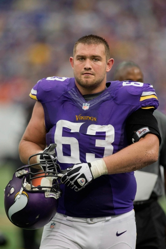 Sep 22, 2013; Minneapolis, MN, USA; Minnesota Vikings offensive lineman Brandon Fusco (63) leaves the field after losing to the Cleveland Browns at Mall of America Field at H.H.H. Metrodome. The Browns win 31-27. Mandatory Credit: Bruce Kluckhohn-USA TODAY Sports