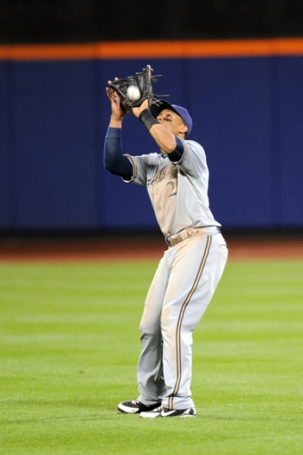 Sep 28, 2013; New York, NY, USA; (Editors note: Caption correction) Milwaukee Brewers center fielder Carlos Gomez (27) catches a fly ball against the New York Mets at Citi Field. The Brewers won the game 4-2. Mandatory Credit- Joe Camporeale-USA TODAY Sports