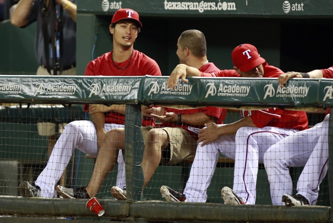 Sep 30, 2013; Arlington, TX, USA; Texas Rangers pitcher Yu Darvish sits in the dugout with his teammates during the fifth inning against the Texas Rangers at Rangers Ballpark at Arlington. Mandatory Credit: Tim Heitman-USA TODAY Sports