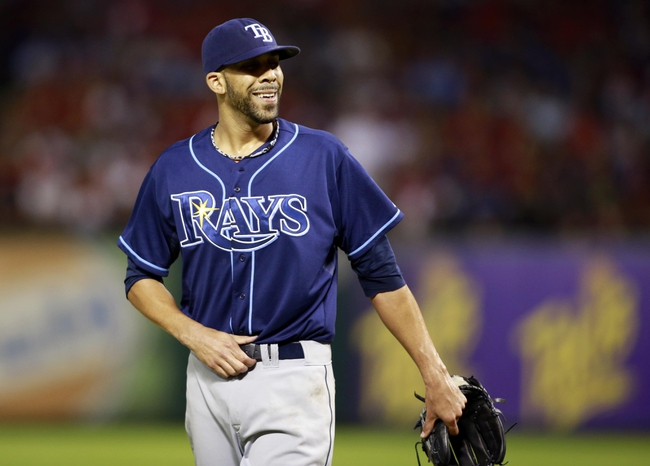 Sep 30, 2013; Arlington, TX, USA; Tampa Bay Rays starting pitcher David Price smiles as he walks back to the dugout during the fifth inning against the Texas Rangers at Rangers Ballpark at Arlington. Mandatory Credit: Tim Heitman-USA TODAY Sports