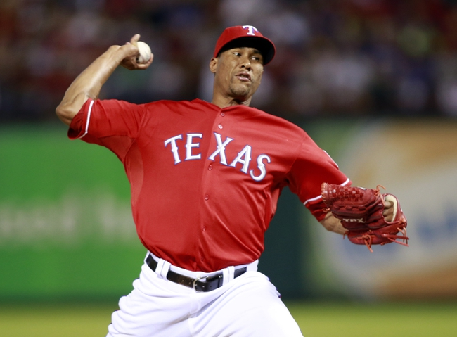 Sep 30, 2013; Arlington, TX, USA; Texas Rangers pitcher Alexi Ogando throws a pitch against the Tampa Bay Rays during the sixth inning at Rangers Ballpark at Arlington. Mandatory Credit: Tim Heitman-USA TODAY Sports