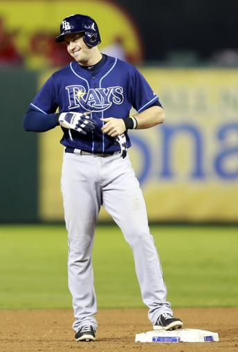 Sep 30, 2013; Arlington, TX, USA; Tampa Bay Rays third baseman Evan Longoria reacts after hitting a double against the Texas Rangers during the sixth inning at Rangers Ballpark at Arlington. Mandatory Credit: Tim Heitman-USA TODAY Sports