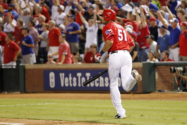 Sep 30, 2013; Arlington, TX, USA; Texas Rangers outfielder Alex Rios hits a RBI double against the Tampa Bay Rays during the sixth inning at Rangers Ballpark at Arlington. Mandatory Credit: Tim Heitman-USA TODAY Sports