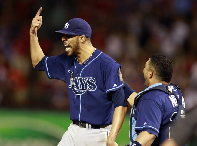 Sep 30, 2013; Arlington, TX, USA; Tampa Bay Rays starting pitcher David Price (left) celebrates with catcher Jose Molina after defeating the Texas Rangers 5-2 at Rangers Ballpark at Arlington. Mandatory Credit: Tim Heitman-USA TODAY Sports