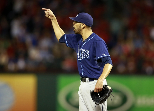Sep 30, 2013; Arlington, TX, USA; Tampa Bay Rays starting pitcher David Price celebrates after defeating the Texas Rangers 5-2 at Rangers Ballpark at Arlington. Mandatory Credit: Tim Heitman-USA TODAY Sports