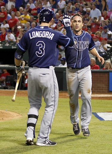 Sep 30, 2013; Arlington, TX, USA; Tampa Bay Rays player Sam Fuld (right) celebrates with third baseman Evan Longoria (3) after scoring a run during the game against the Tampa Bay Rays at Rangers Ballpark at Arlington. Mandatory Credit: Tim Heitman-USA TODAY Sports