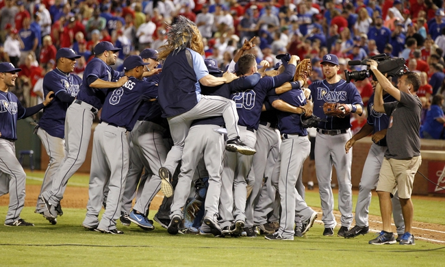 Sep 30, 2013; Arlington, TX, USA; Members of the Tampa Bay Rays celebrate after defeating the Texas Rangers 5-2 at Rangers Ballpark at Arlington. Mandatory Credit: Tim Heitman-USA TODAY Sports