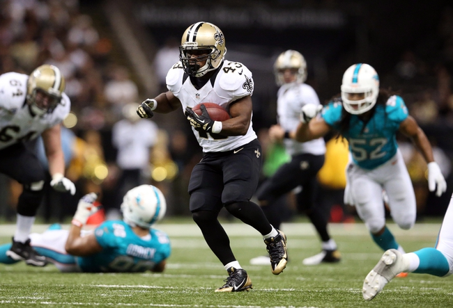 Sep 30, 2013; New Orleans, LA, USA;  New Orleans Saints running back Darren Sproles (43) carries the ball in the fourth quarter against the Miami Dolphins at Mercedes-Benz Superdome. New Orleans defeated Miami 38-17. Mandatory Credit: Crystal LoGiudice-USA TODAY Sports