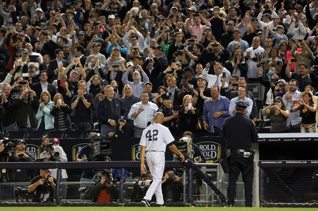 Sep 26, 2013; Bronx, NY, USA; New York Yankees relief pitcher Mariano Rivera (42) takes a curtain call during the ninth inning of his final home game against the Tampa Bay Rays at Yankee Stadium. Mandatory Credit: Brad Penner-USA TODAY Sports