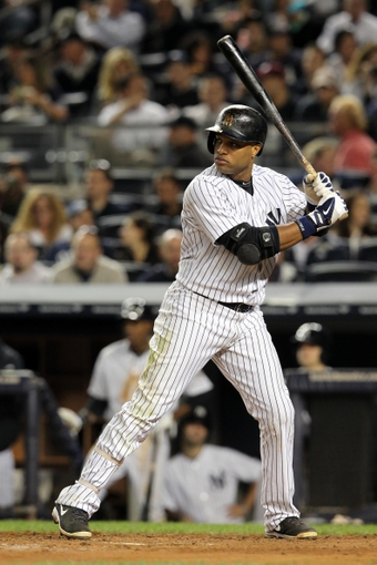 Sep 26, 2013; Bronx, NY, USA; New York Yankees second baseman Robinson Cano (24) bats against the Tampa Bay Rays during a game at Yankee Stadium. Mandatory Credit: Brad Penner-USA TODAY Sports