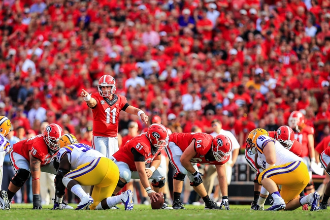 Sep 28, 2013; Athens, GA, USA; Georgia Bulldogs quarterback Aaron Murray (11) calls a play at the line in the first half against the LSU Tigers at Sanford Stadium. Georgia won 44-41. Mandatory Credit: Daniel Shirey-USA TODAY Sports
