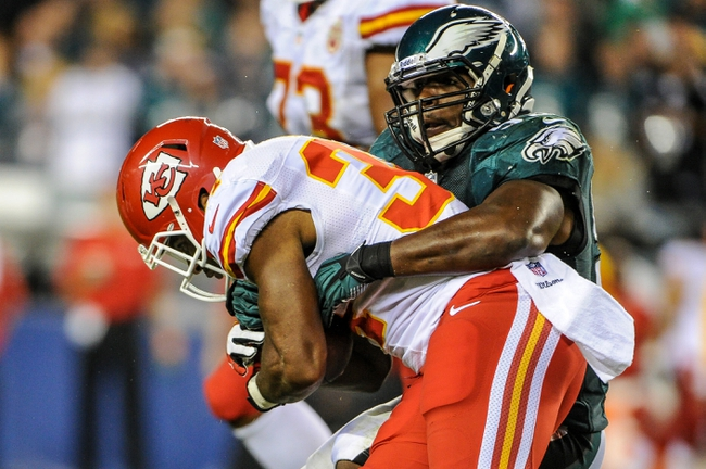 Sep 19, 2013; Philadelphia, PA, USA; Philadelphia Eagles inside linebacker DeMeco Ryans (59) tackles Kansas City Chiefs running back Knile Davis (34) during the fourth quarter of the game at Lincoln Financial Field. The Kansas City Chiefs beat the Philadelphia Eagles 26-16. Mandatory Credit: John Geliebter-USA TODAY Sports