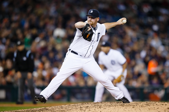 Sep 17, 2013; Detroit, MI, USA; Detroit Tigers relief pitcher Phil Coke (40) pitches against the Seattle Mariners at Comerica Park. Mandatory Credit: Rick Osentoski-USA TODAY Sports