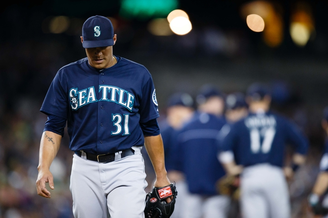 Sep 17, 2013; Detroit, MI, USA; Seattle Mariners relief pitcher Yoervis Medina (31) walks off the field after being relieved in the seventh inning against the Detroit Tigers at Comerica Park. Mandatory Credit: Rick Osentoski-USA TODAY Sports