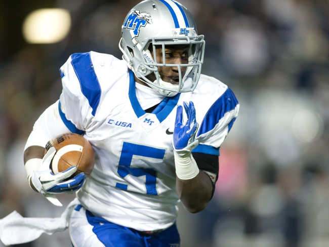 Sep 27, 2013; Provo, UT, USA; Middle Tennessee Blue Raiders running back Jeremiah Bryson (5) runs with the ball during the second half against the Brigham Young Cougars at Lavell Edwards Stadium. Brigham Young won 37-10. Mandatory Credit: Russ Isabella-USA TODAY Sports