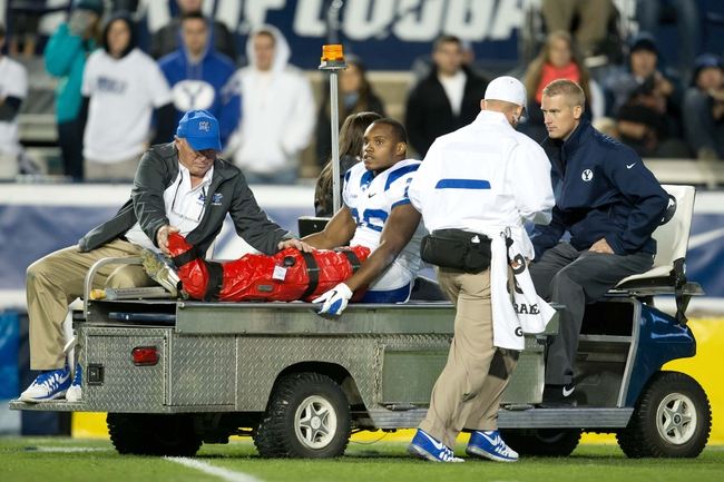 Sep 27, 2013; Provo, UT, USA; Middle Tennessee Blue Raiders running back William Pratcher (29) is taken from the field after sustaining a leg injury during the second half against the Brigham Young Cougars at Lavell Edwards Stadium. Brigham Young won 37-10. Mandatory Credit: Russ Isabella-USA TODAY Sports