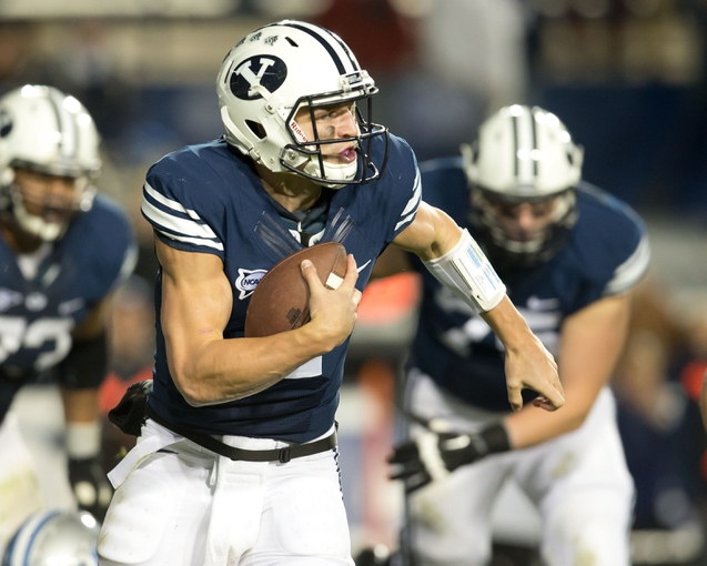 Sep 27, 2013; Provo, UT, USA; Brigham Young Cougars quarterback Taysom Hill (4) runs with the ball during the first half against the Middle Tennessee Blue Raiders at Lavell Edwards Stadium. Brigham Young won 37-10. Mandatory Credit: Russ Isabella-USA TODAY Sports
