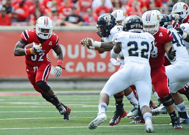 Sep 21, 2013; Louisville, KY, USA; Louisville Cardinals running back Senorise Perry (32) runs the ball against the FIU Golden Panthers during the second quarter of play at Papa John's Cardinal Stadium. Louisville defeated FIU 72-0.  Mandatory Credit: Jamie Rhodes-USA TODAY Sports