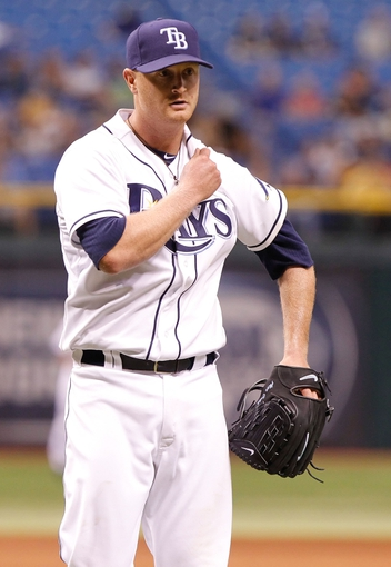 Sep 16, 2013; St. Petersburg, FL, USA; Tampa Bay Rays starting pitcher Alex Cobb (53) walks back to the dugout against the Texas Rangers at Tropicana Field. Tampa Bay Rays defeated the Texas Rangers 6-2. Mandatory Credit: Kim Klement-USA TODAY Sports