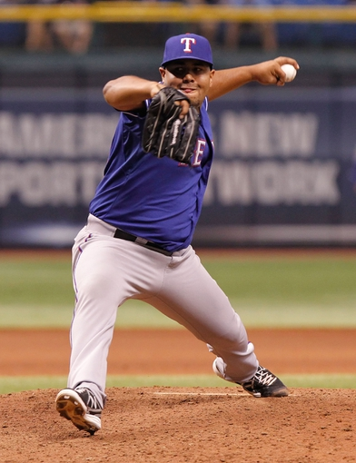 Sep 16, 2013; St. Petersburg, FL, USA; Texas Rangers relief pitcher Joe Ortiz (58) throws a pitch against the Tampa Bay Rays  at Tropicana Field. Tampa Bay Rays defeated the Texas Rangers 6-2. Mandatory Credit: Kim Klement-USA TODAY Sports
