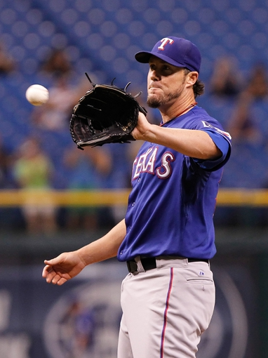 Sep 18, 2013; St. Petersburg, FL, USA; Texas Rangers relief pitcher Joe Nathan (36) against the Tampa Bay Rays at Tropicana Field. Tampa Bay Rays defeated the Texas Rangers 4-3 in twelve inning. Mandatory Credit: Kim Klement-USA TODAY Sports