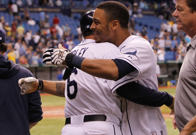 Sep 18, 2013; St. Petersburg, FL, USA; Tampa Bay Rays center fielder Desmond Jennings (8) is congratulated by third base coach Tom Foley (6) after he hit the game winning RBI single against the Texas Rangers at Tropicana Field. Tampa Bay Rays defeated the Texas Rangers 4-3 in twelve inning. Mandatory Credit: Kim Klement-USA TODAY Sports