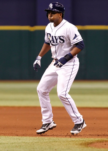 Sep 18, 2013; St. Petersburg, FL, USA; Tampa Bay Rays outfielder Freddy Guzman (43) leads off against the Texas Rangers at Tropicana Field. Tampa Bay Rays defeated the Texas Rangers 4-3 in twelve inning. Mandatory Credit: Kim Klement-USA TODAY Sports