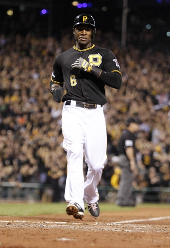 Oct 1, 2013; Pittsburgh, PA, USA; Pittsburgh Pirates left fielder Starling Marte (6) scores a run in the fourth inning of the National League wild card playoff baseball game against the Cincinnati Reds at PNC Park. Mandatory Credit: Charles LeClaire-USA TODAY Sports