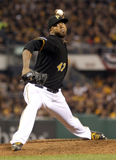 Oct 1, 2013; Pittsburgh, PA, USA; Pittsburgh Pirates starting pitcher Francisco Liriano throws a pitch against the Cincinnati Reds in the sixth inning of the National League wild card playoff baseball game at PNC Park. The Pirates won 6-2. Mandatory Credit: Charles LeClaire-USA TODAY Sports