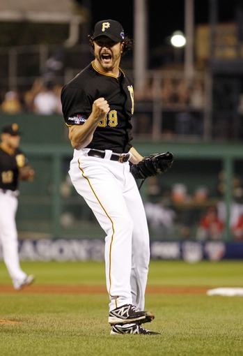Oct 1, 2013; Pittsburgh, PA, USA; Pittsburgh Pirates relief pitcher Jason Grilli reacts after recording the final out in the National League wild card playoff baseball game against the Cincinnati Reds at PNC Park. The Pirates won 6-2. Mandatory Credit: Charles LeClaire-USA TODAY Sports