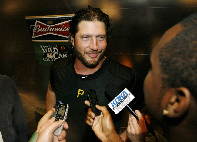 Oct 1, 2013; Pittsburgh, PA, USA; Pittsburgh Pirates relief pitcher Jason Grilli (39) talks with reporters in the clubhouse after defeating the Cincinnati Reds in the National League wild card playoff baseball game at PNC Park. The Pirates won 6-2. Mandatory Credit: Charles LeClaire-USA TODAY Sports