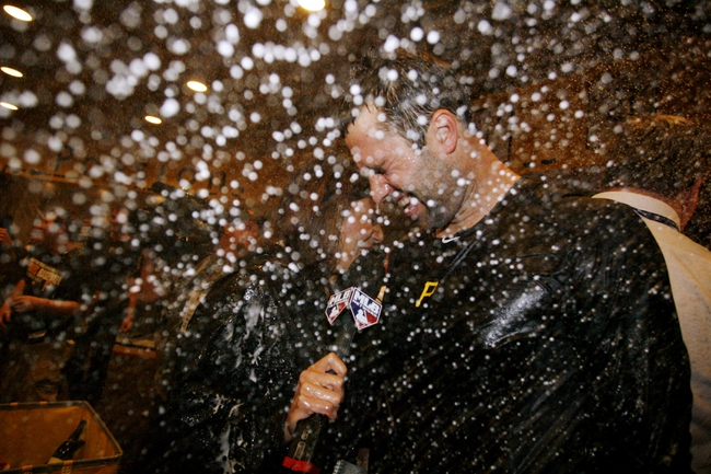 Oct 1, 2013; Pittsburgh, PA, USA; Pittsburgh Pirates second baseman Neil Walker is sprayed with champagne as he is interviewed in the clubhouse after defeating the Cincinnati Reds in the National League wild card playoff baseball game at PNC Park. The Pirates won 6-2. Mandatory Credit: Charles LeClaire-USA TODAY Sports