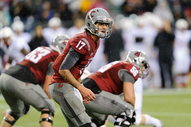 Sep 28, 2013; Seattle, WA, USA; Washington State Cougars quarterback Austin Apodaca (17) calls out plays at the line during the game against the Stanford Cardinal at CenturyLink Field. Stanford defeated Washington State 55-17. Mandatory Credit: Steven Bisig-USA TODAY Sports