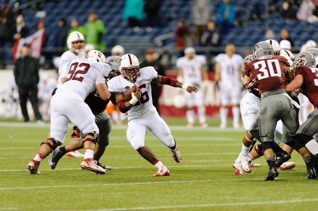 Sep 28, 2013; Seattle, WA, USA; Stanford Cardinal running back Barry Sanders (26) carries the ball against the Washington State Cougars during the game at CenturyLink Field. Stanford defeated Washington State 55-17. Mandatory Credit: Steven Bisig-USA TODAY Sports