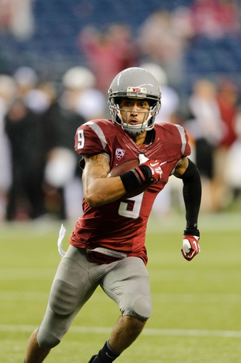 Sep 28, 2013; Seattle, WA, USA; Washington State Cougars wide receiver Gabe Marks (9) runs with the ball after making a catch against the Stanford Cardinal during the game at CenturyLink Field. Stanford defeated Washington State 55-17. Mandatory Credit: Steven Bisig-USA TODAY Sports