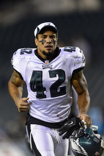 Aug 15, 2013; Philadelphia, PA, USA; Philadelphia Eagles safety Kurt Coleman (42) leaves the field after playing the Carolina Panthers at Lincoln Financial Field. The Eagles defeated the Panthers 14-9. Mandatory Credit: Howard Smith-USA TODAY Sports