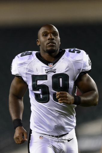 Aug 15, 2013; Philadelphia, PA, USA; Philadelphia Eagles linebacker DeMeco Ryans (59) leaves the field after playing the Carolina Panthers at Lincoln Financial Field. The Eagles defeated the Panthers 14-9. Mandatory Credit: Howard Smith-USA TODAY Sports