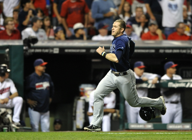 Oct 2, 2013; Cleveland, OH, USA; Tampa Bay Rays third baseman Evan Longoria (3) scores against the Cleveland Indians during the fourth inning in the American League wild card playoff game at Progressive Field. Mandatory Credit: David Richard-USA TODAY Sports