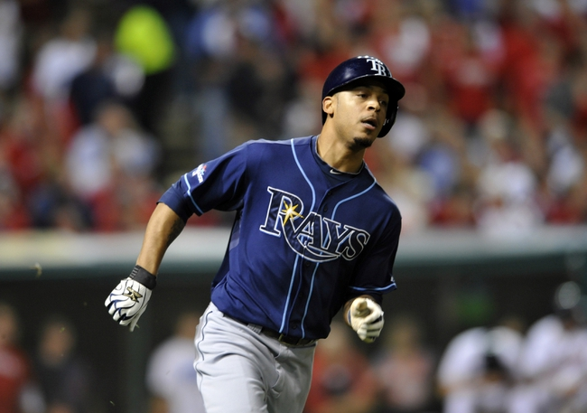 Oct 2, 2013; Cleveland, OH, USA; Tampa Bay Rays center fielder Desmond Jennings (8) runs out a 2 RBI double against the Cleveland Indians during the fourth inning in the American League wild card playoff game at Progressive Field. Mandatory Credit: David Richard-USA TODAY Sports