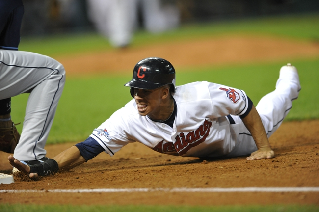 Oct 2, 2013; Cleveland, OH, USA; Cleveland Indians left fielder Michael Brantley (23) dives back to first base against the Tampa Bay Rays during the first inning in the American League wild card playoff game at Progressive Field. Mandatory Credit: David Richard-USA TODAY Sports