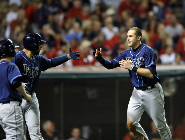 Oct 2, 2013; Cleveland, OH, USA; Tampa Bay Rays third baseman Evan Longoria (3) celebrates after scoring against the Cleveland Indians during the fourth inning in the American League wild card playoff game at Progressive Field. Mandatory Credit: David Richard-USA TODAY Sports