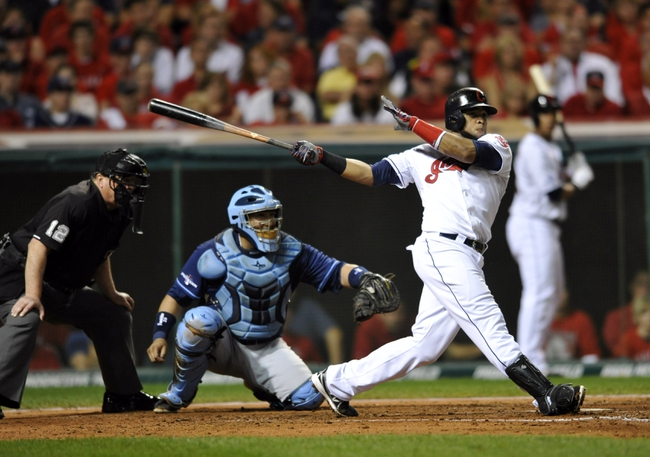 Oct 2, 2013; Cleveland, OH, USA; Cleveland Indians designated hitter Carlos Santana (41) hits a double against the Tampa Bay Rays during the fourth inning in the American League wild card playoff game at Progressive Field. Mandatory Credit: David Richard-USA TODAY Sports