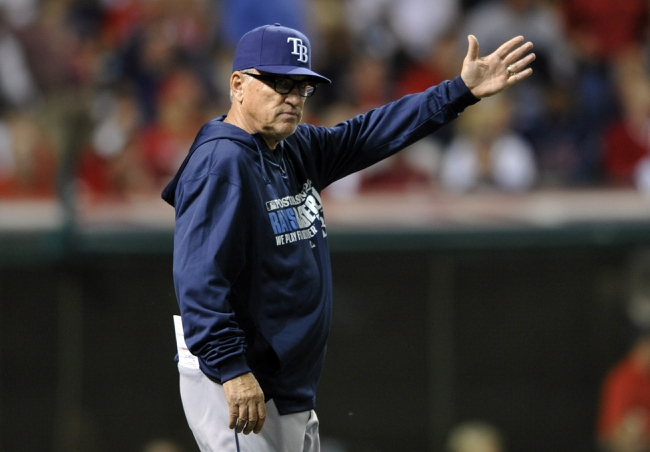 Oct 2, 2013; Cleveland, OH, USA; Tampa Bay Rays manager Joe Maddon (70) makes a pitching change in the eighth inning in the American League wild card playoff game against the Cleveland Indians at Progressive Field. Mandatory Credit: David Richard-USA TODAY Sports