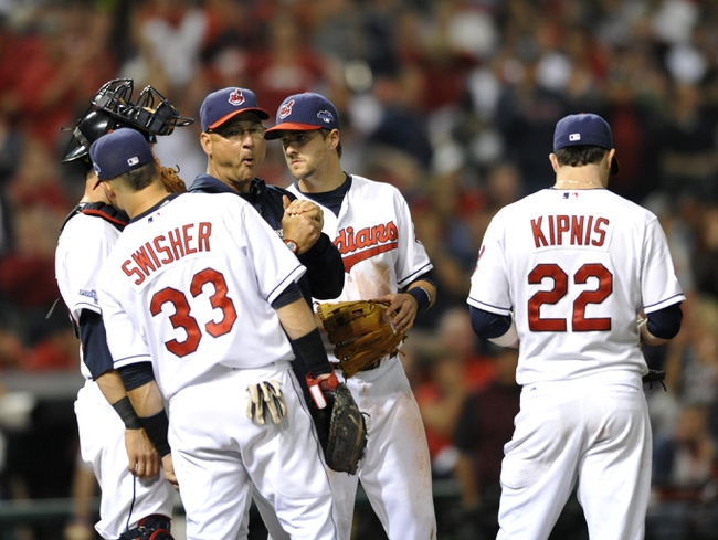 Oct 2, 2013; Cleveland, OH, USA; Cleveland Indians manager Terry Francona (17) makes a pitching change during the 7th inning in the American League wild card playoff game against the Tampa Bay Rays at Progressive Field. Mandatory Credit: David Richard-USA TODAY Sports